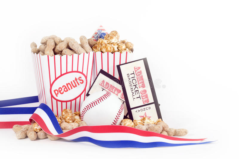 Baseball Concept. Baseball, peanuts and crackerjacks (traditional carmel coated popcorn eaten at baseball games) with two game tickets, and red, white and blue