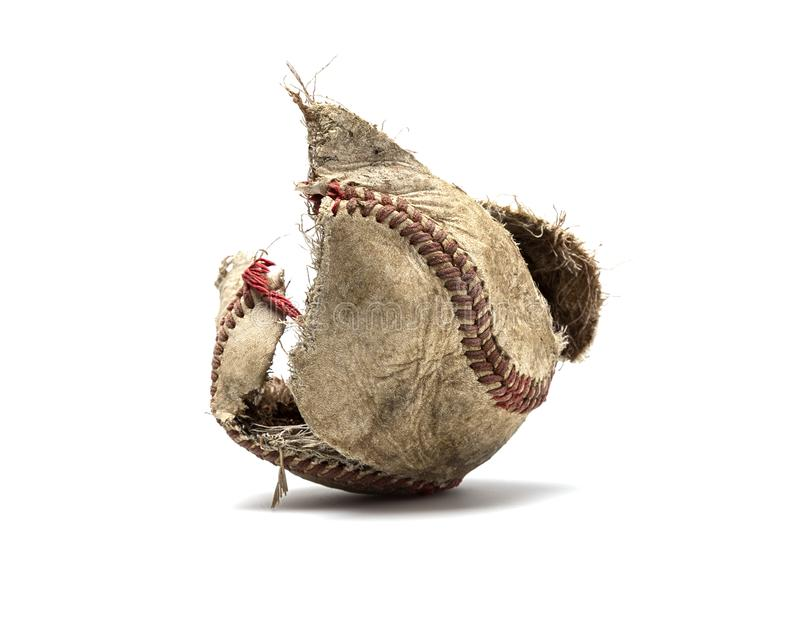Knocked The Cover Off The Baseball. Baseball with the cover torn off the center core of the ball on white background stock photography