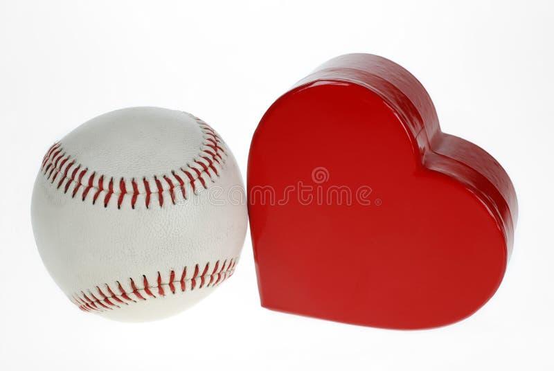 Baseball e cuore fotografia stock