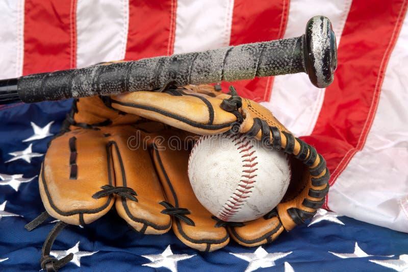 Baseball equipment on American flag royalty free stock image