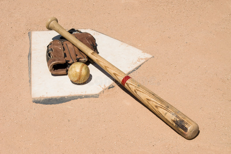 Baseball equipment on home plate royalty free stock photos