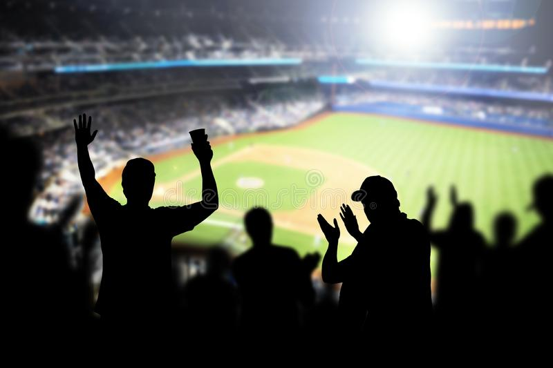 Baseball fans and crowd cheering in stadium. stock photos