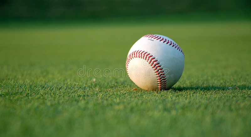 Baseball on the field stock photography