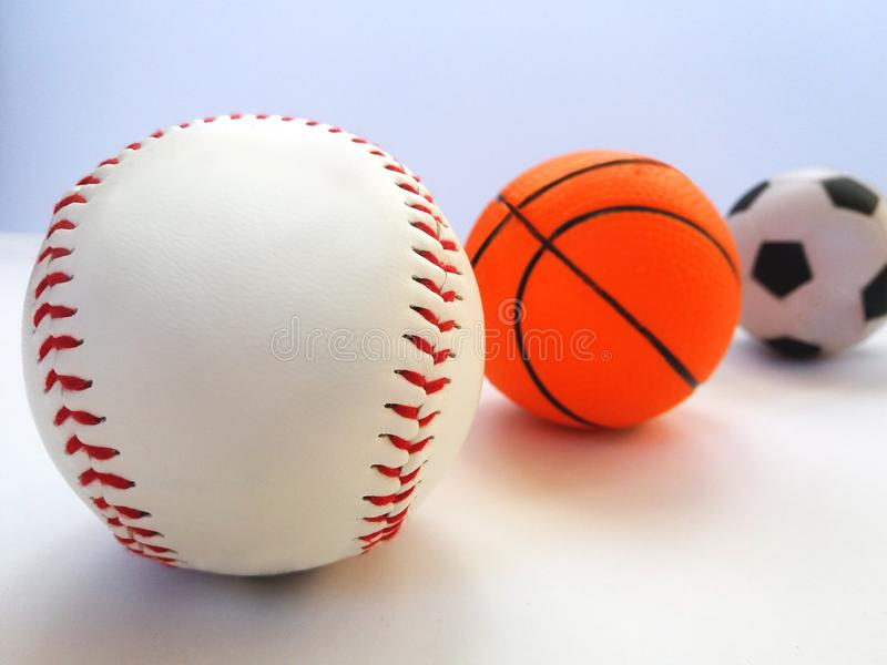 Baseball, football, basketball. Three sports balls on a light background for cards, banners, flyers. stock image