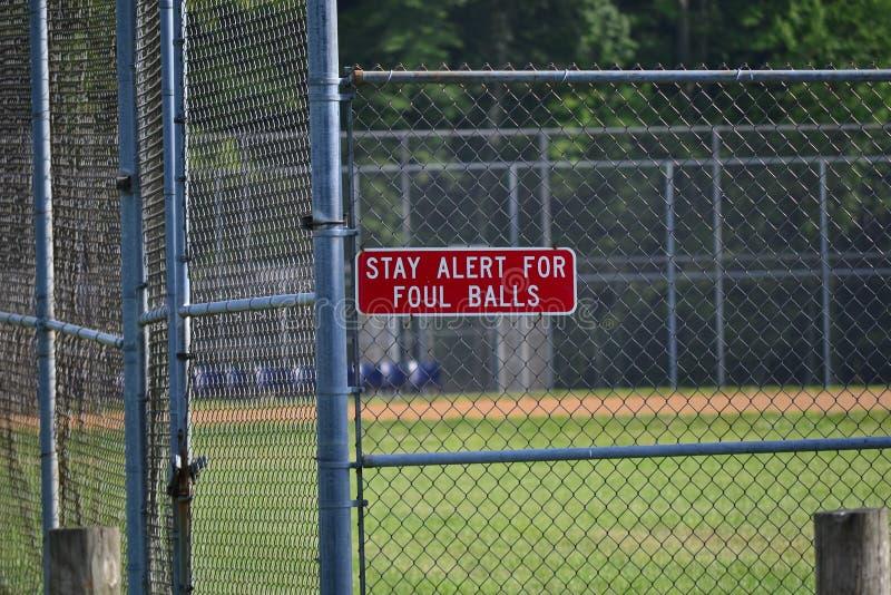 Baseball Foul Ball Warning Sign royalty free stock image