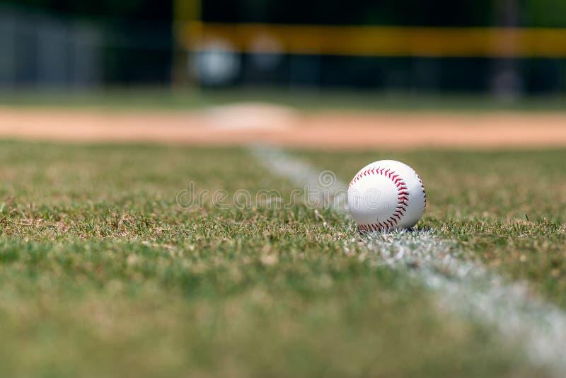 Baseball on foul line background stock images