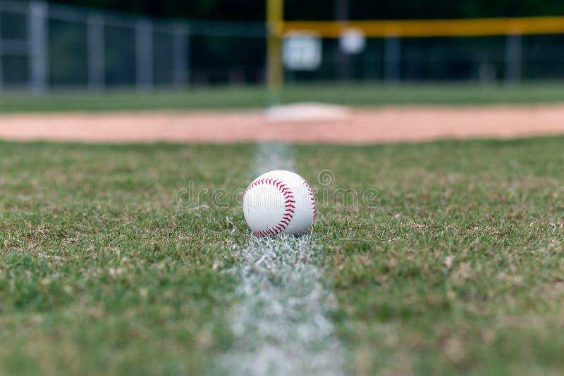 Baseball on foul line background royalty free stock photography
