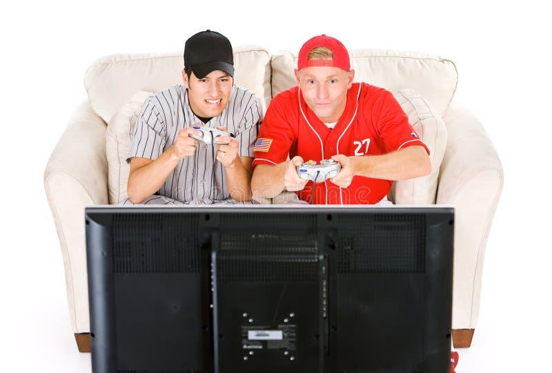 Baseball: Freunde, die Videospiele spielen lizenzfreie stockfotografie