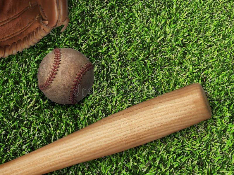 Baseball, glove, ball and bat on field royalty free stock image