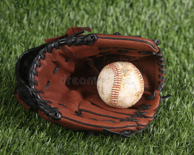 Baseball And Glove On The Grass Royalty Free Stock Photos