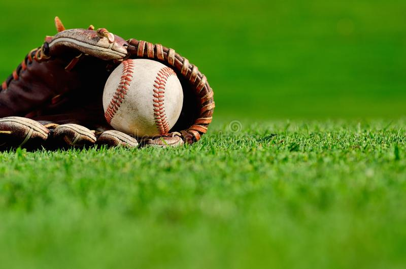 Baseball in glove stock images