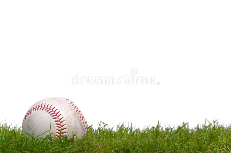 Baseball in the grass royalty free stock photos