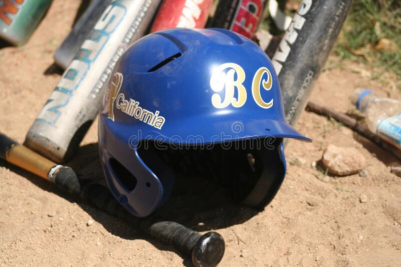 Baseball helmet and bats sports outdoor. Casco de beisbol y bat deportes intemperie royalty free stock photography