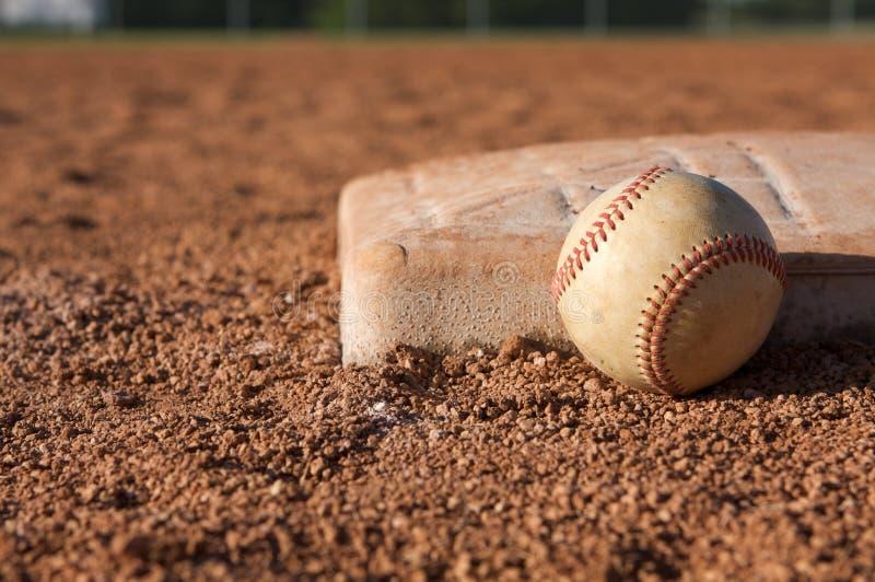 Baseball near the base stock photo
