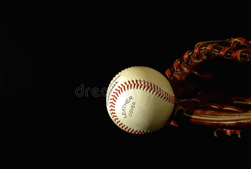 Baseball nello scuro fotografie stock