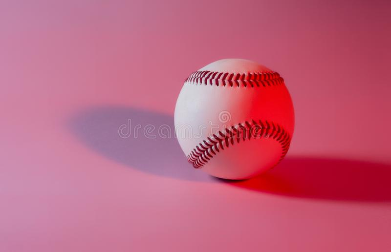 Baseball on a Pink color background and red stitching baseball. Copy space stock images