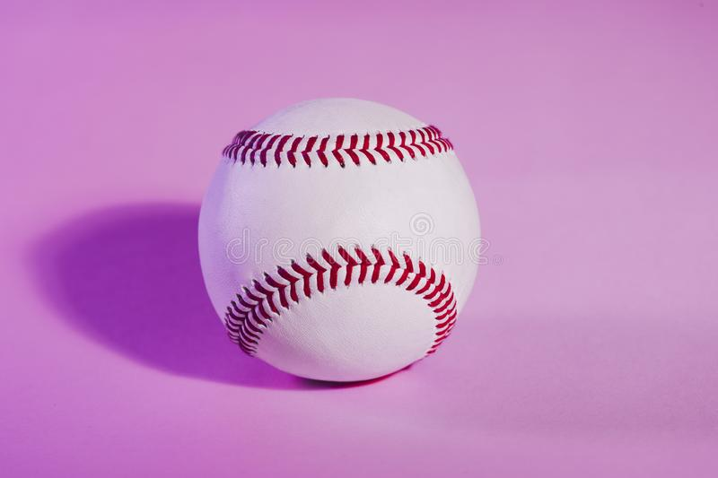 Baseball on a Pink color background and red stitching baseball. Copy space stock photos