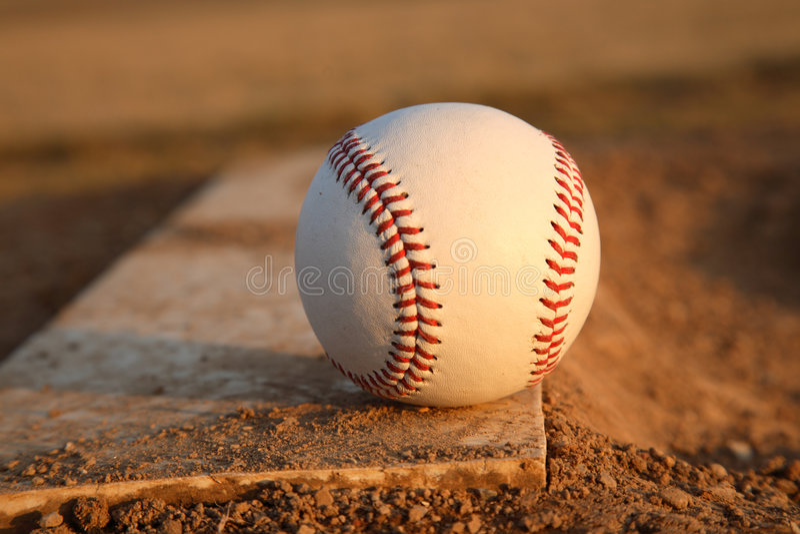 Baseball on Pitchers Mound Rubber royalty free stock photo