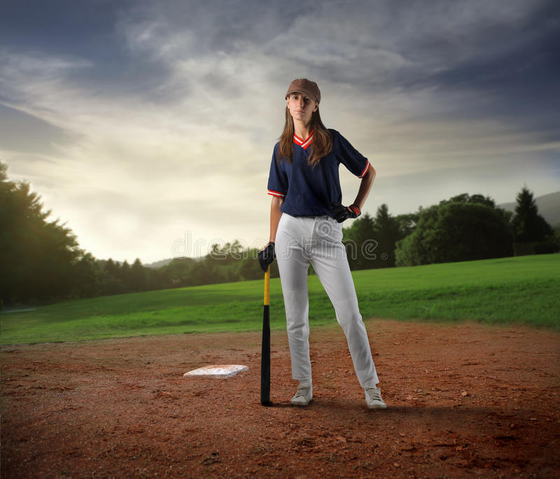 Baseball player. Female baseball player standing in a field royalty free stock photos
