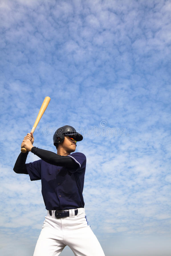 Baseball player. And cloud background stock image