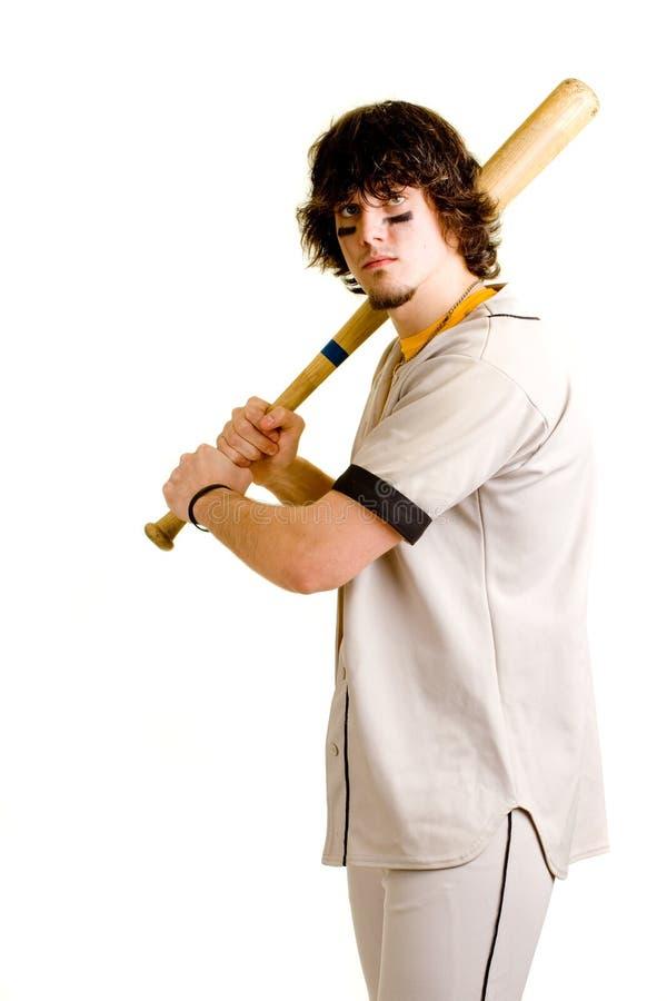Baseball Player. A young male baseball player batting royalty free stock images
