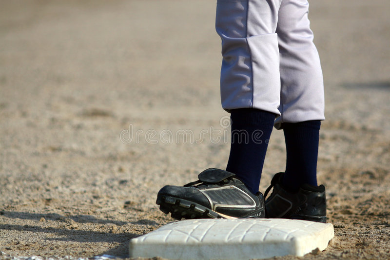 Baseball player on base stock photography