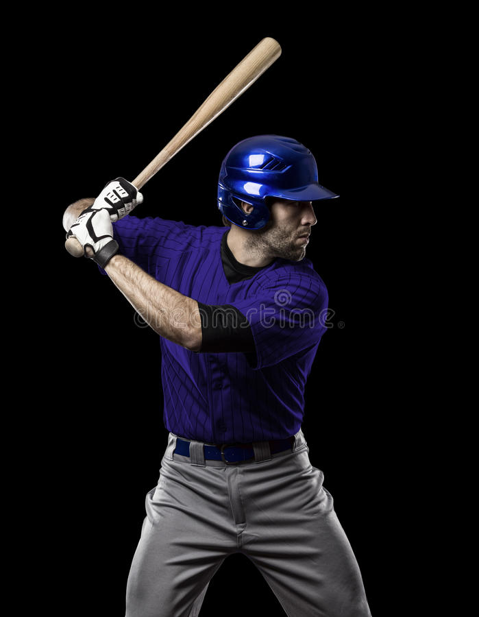 Baseball Player. With a blue uniform on a black background stock photography