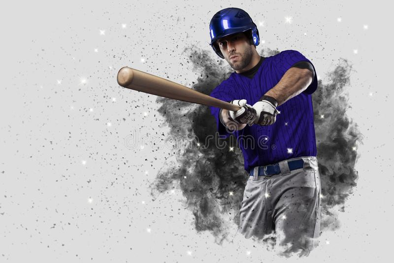 Baseball Player. With a Blue uniform coming out of a blast of smoke royalty free stock image