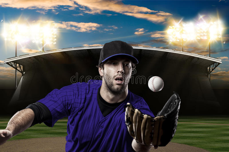 Baseball Player. With a blue uniform on baseball Stadium stock photography