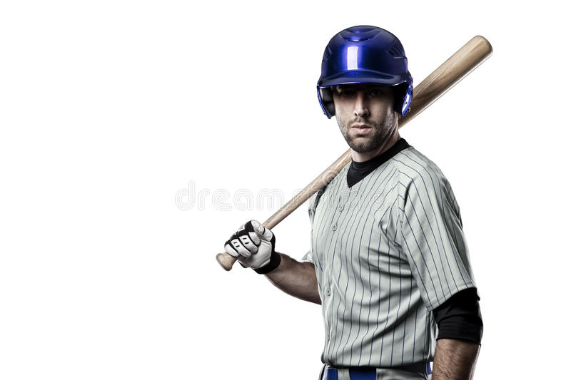 Baseball Player. In a blue uniform, on a white background royalty free stock photos
