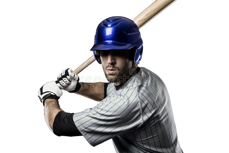 Baseball Player. In a blue uniform, on a white background royalty free stock images