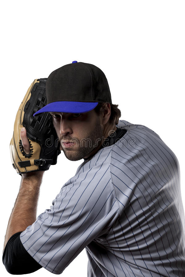 Baseball Player. In a blue uniform, on a white background stock image