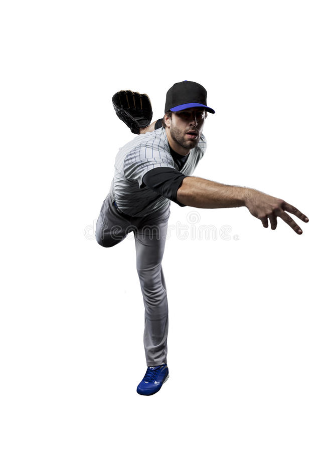 Baseball Player. In a blue uniform, on a white background royalty free stock photo