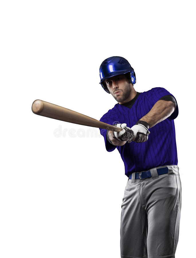 Baseball Player. With a blue uniform on a white background royalty free stock images