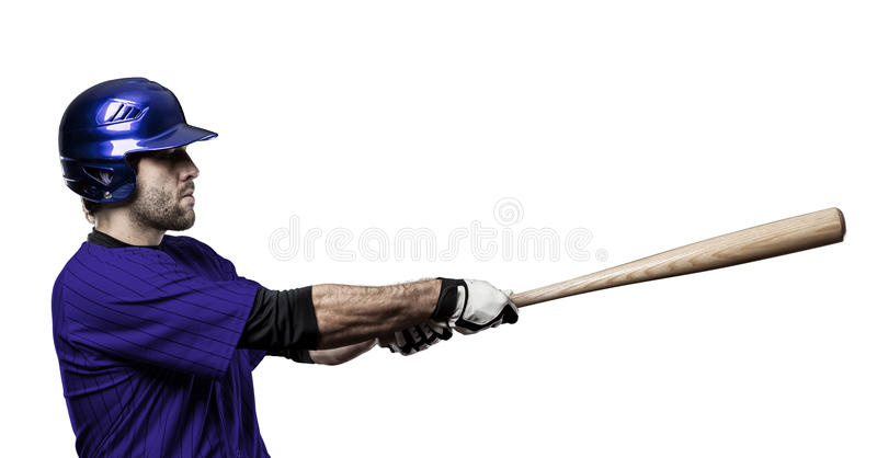 Baseball Player. With a blue uniform on a white background royalty free stock image