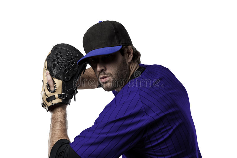 Baseball Player. With a blue uniform on a white background royalty free stock photos