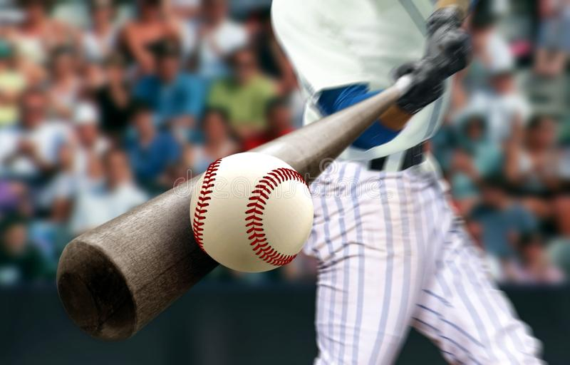 Baseball player hitting ball with bat in close up stock image