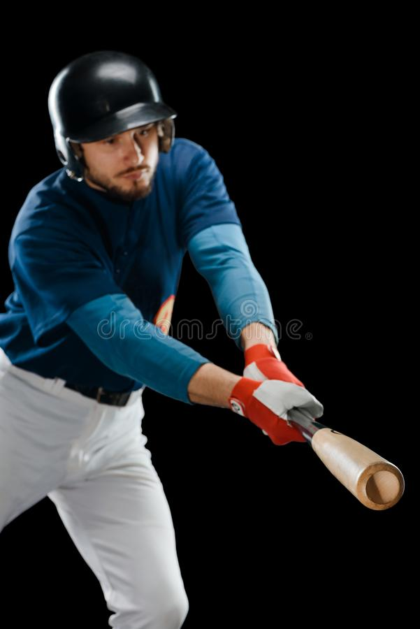 Baseball player hitting a ball stock photography