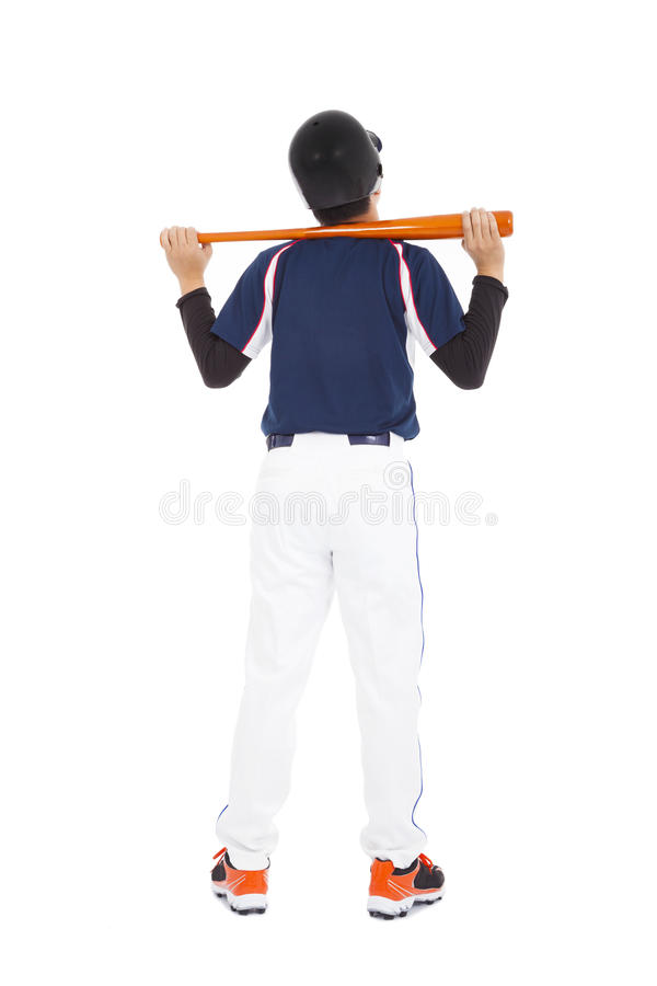 Baseball player holding bat back to standing royalty free stock photos