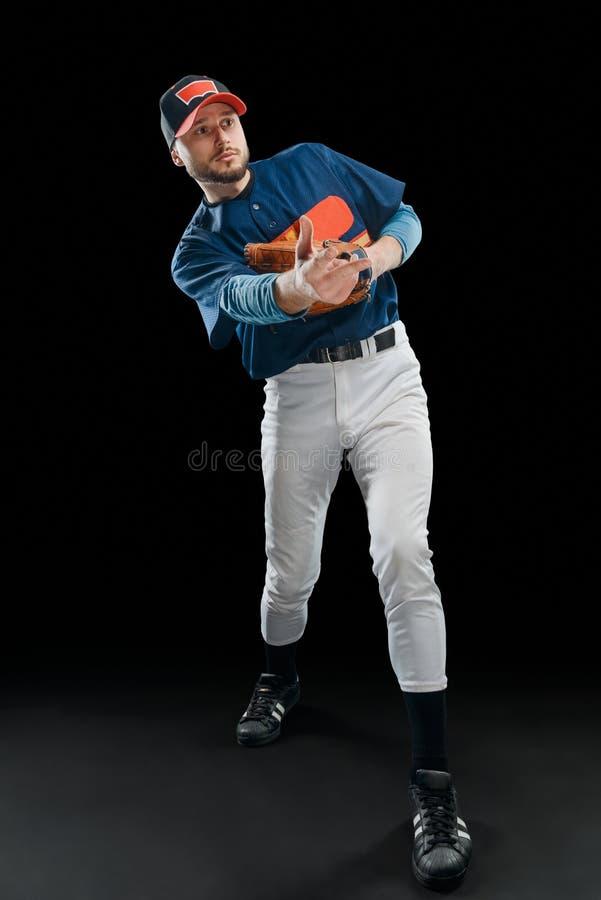 Baseball player made a pitch stock photos