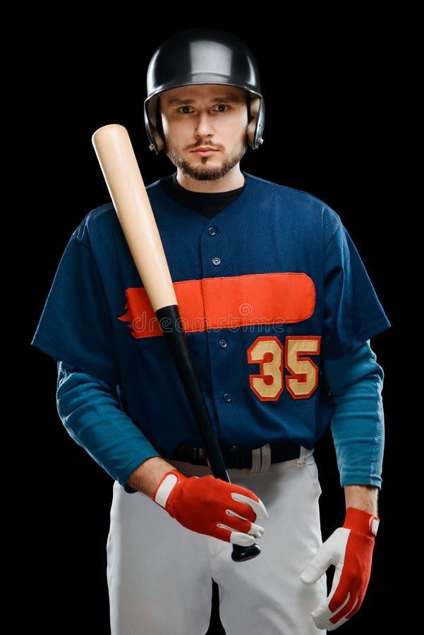 Baseball player posing with bat stock image
