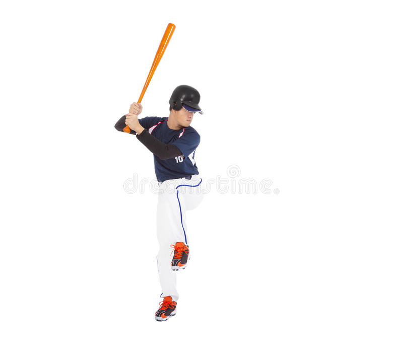 Baseball player ready to hit with bat on the side. royalty free stock photography