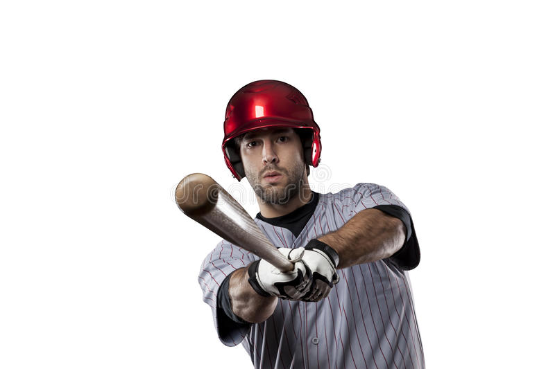 Baseball Player. In red uniform, on a white background royalty free stock photo