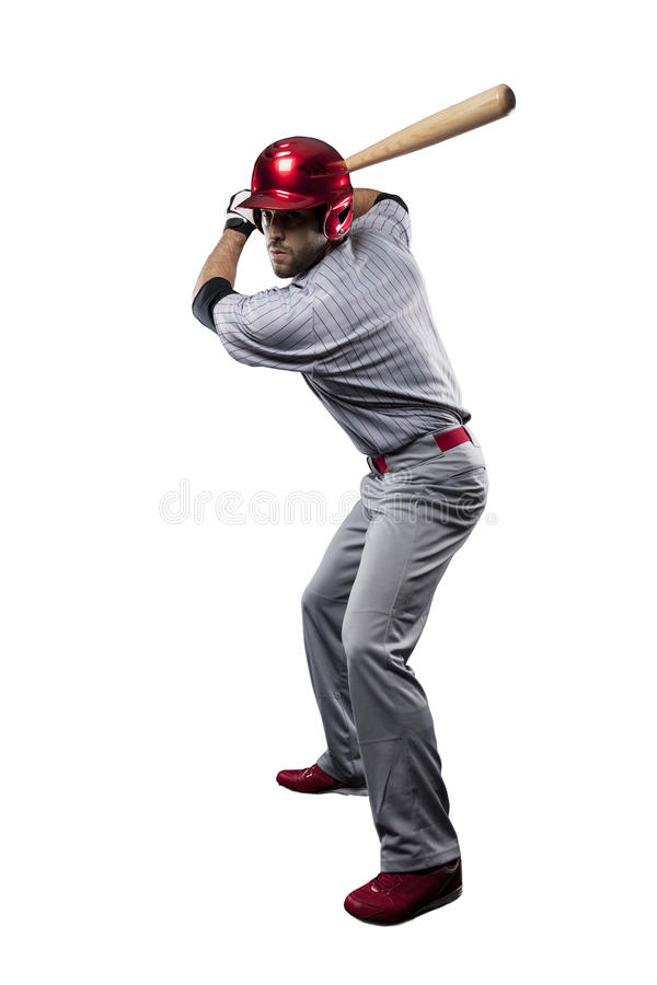 Baseball Player. In red uniform, on a white background stock photos