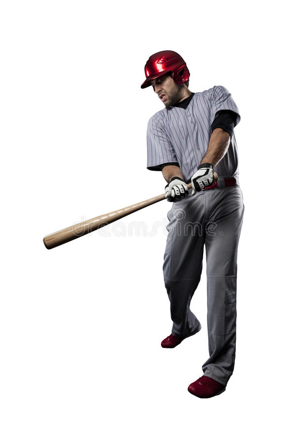 Baseball Player. In red uniform, on a white background royalty free stock photography