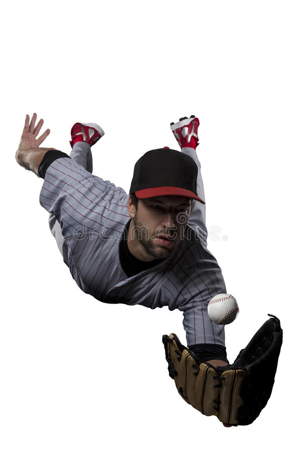 Baseball Player. In red uniform, on a white background royalty free stock image