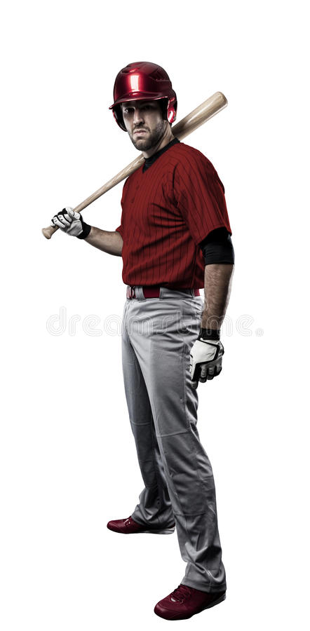 Baseball Player. With a red uniform on white background royalty free stock photos