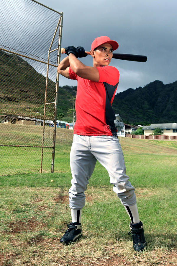 Baseball player stands at bat stock images