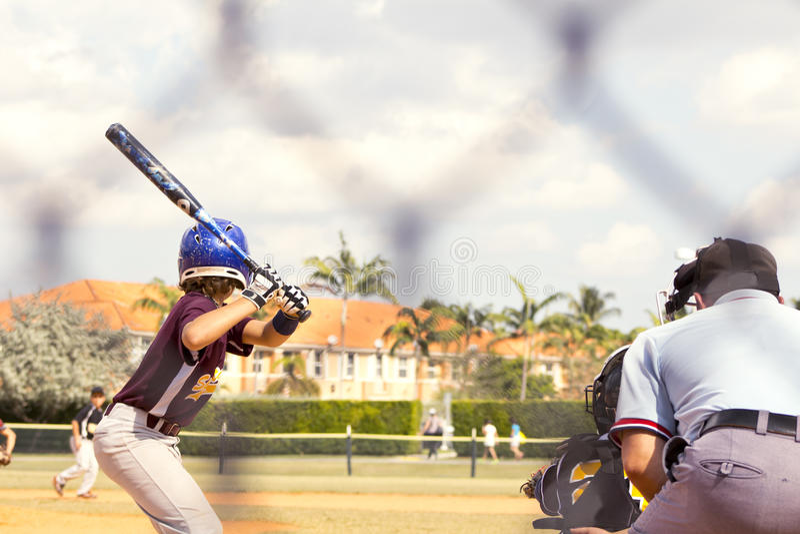 Baseball Players. Kids playing Baseball in youth league royalty free stock image