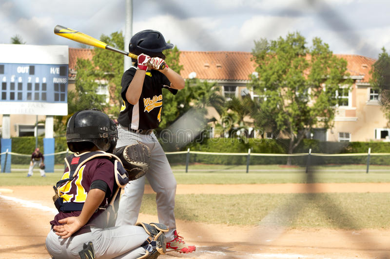 Baseball Players. Kids playing Baseball in youth league stock images